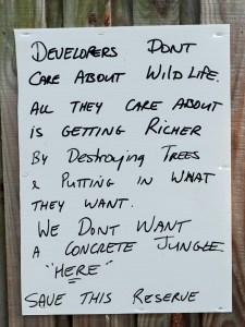 Sign on fence in Teak Lane