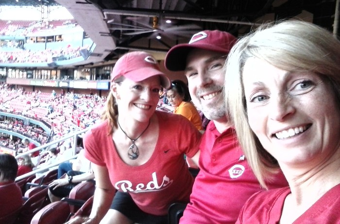 Daughter Kym w/friends and royal Reds fans Ken and Wendy of Cincinnati.