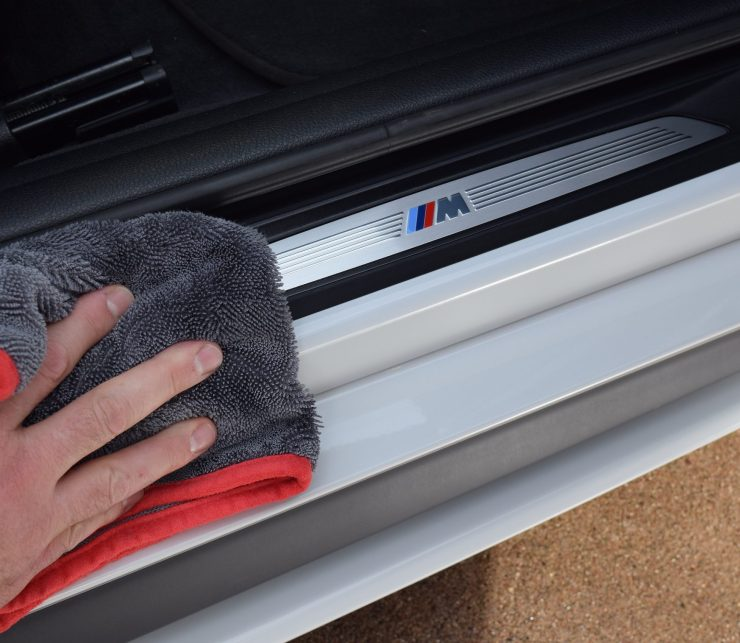 The Finisher small microfiber drying towel drying door jambs