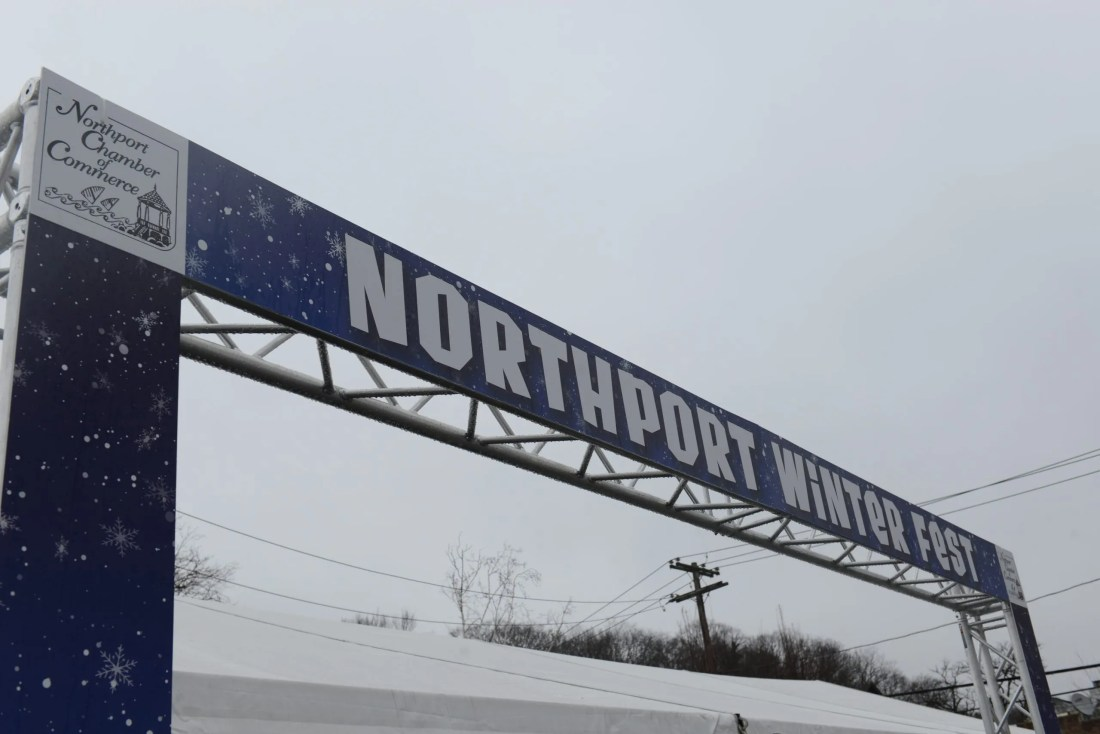 branded truss arch for northport winder fest entrance to tent