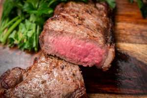 Broiled strip steaks