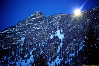Moon Dipping Behind Mountains