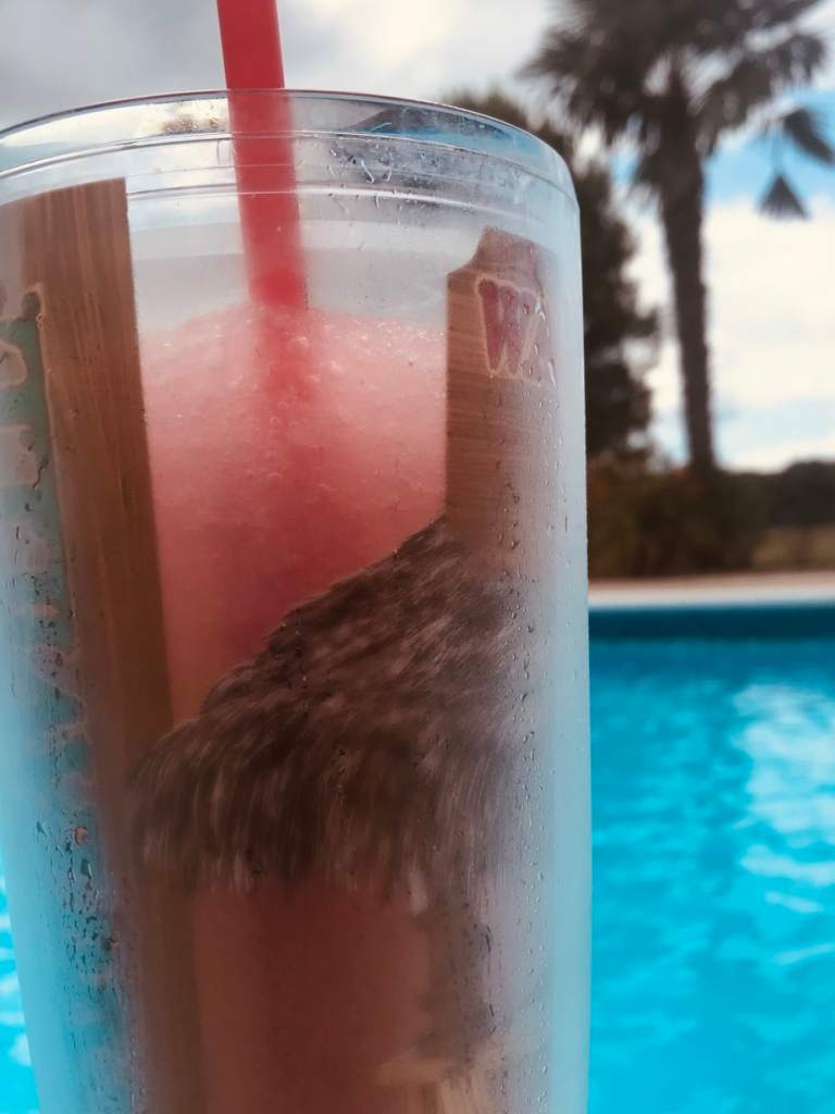 Chilling by the pool with a Frozen Lemonberry Libation to cool off with.