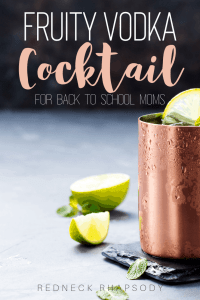 Cold glass with cocktail and lime garnish