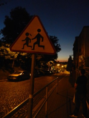 This sign looks like a man chasing a little girl…
