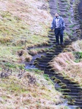 93-the-man-makes-his-way-down-skogafoss