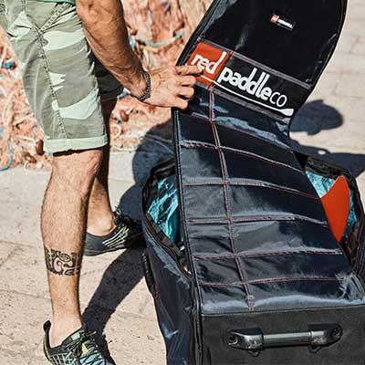 Image of man unzipping bag