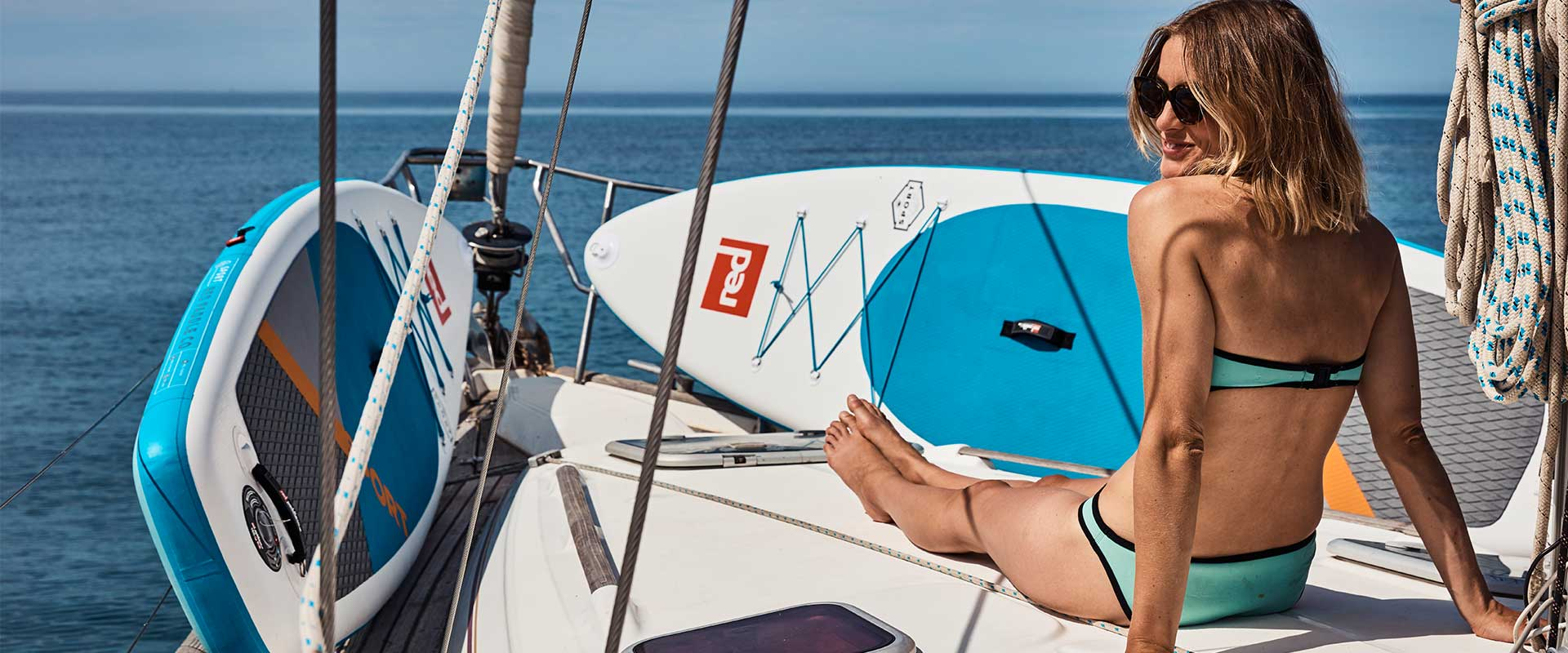 Image of Red Paddle Co board and girl on yatch