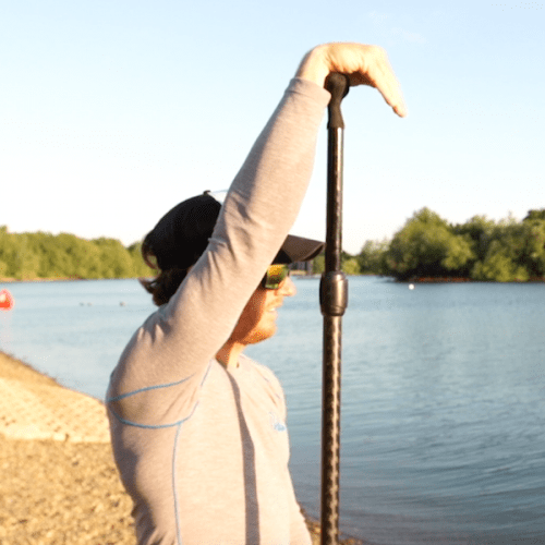 man measuring paddle with arm