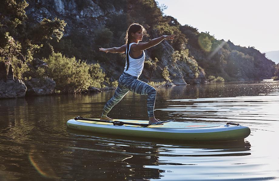 Girl performs sup yoga pose in SUP leggings