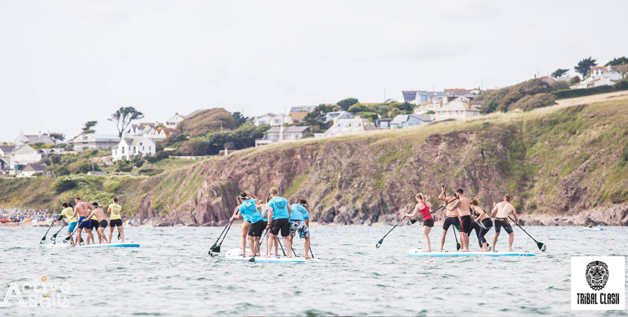 Teams on paddle boards