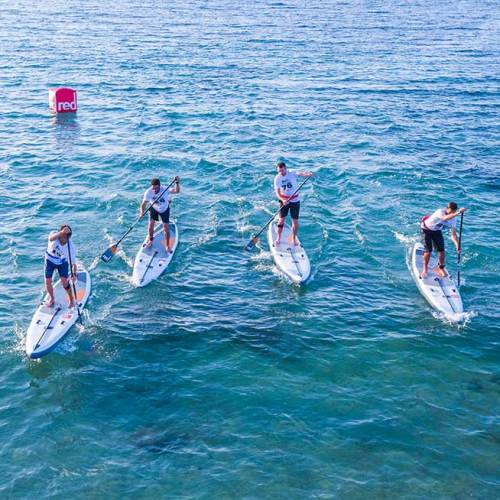 "group finish to an SUP race on Red Paddle Co 14'0"" Elite inflatable boards"