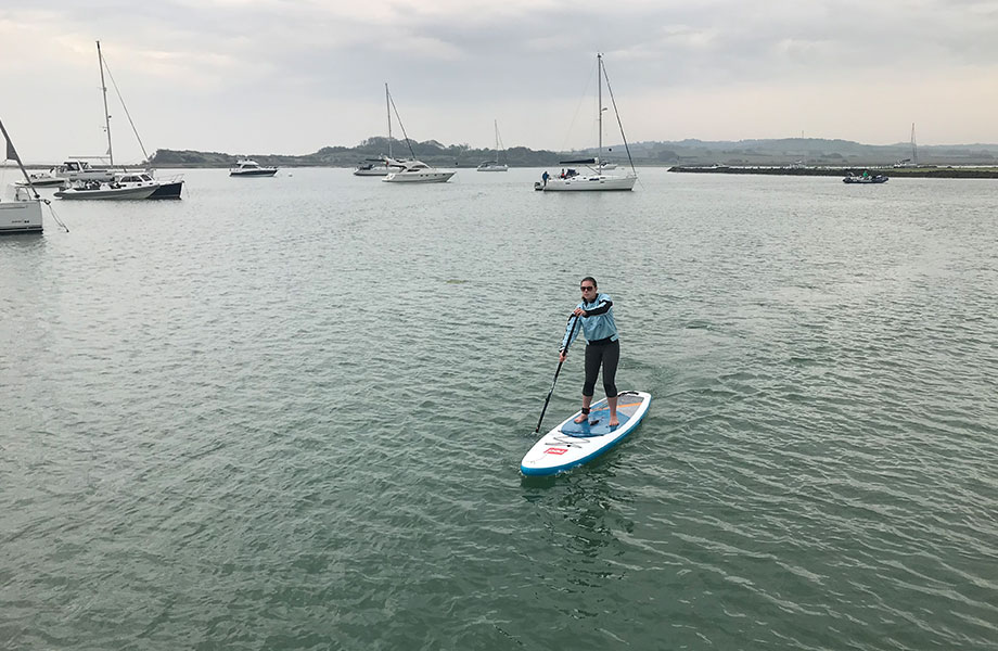 Scientist paddle boarding