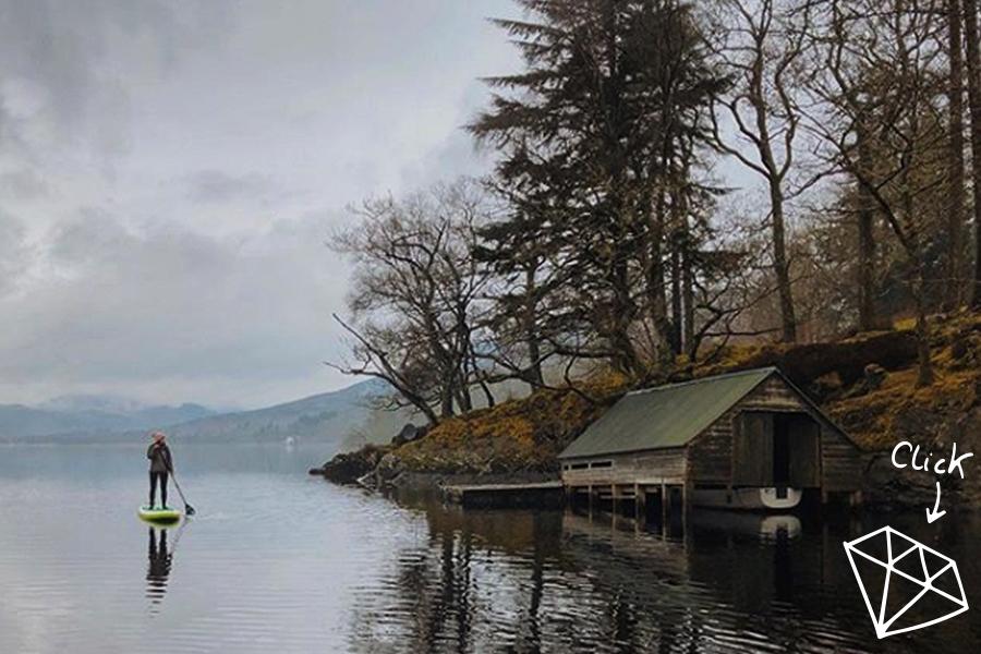 girl paddles on loch in winter