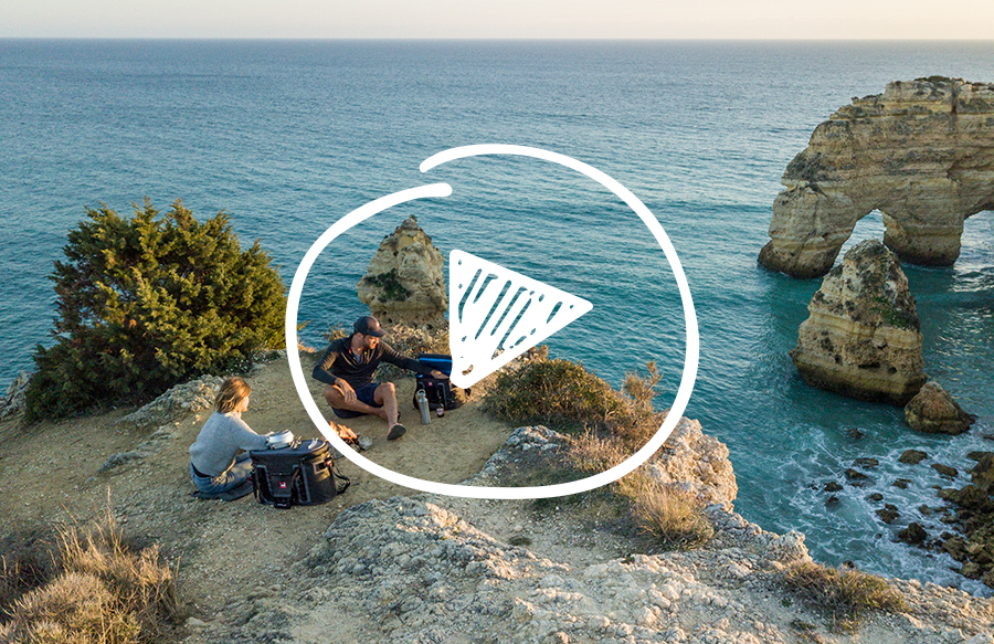 Friends sit and have picnic on cliff