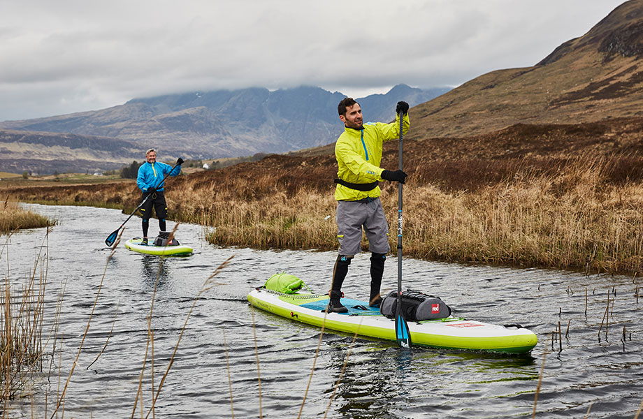 two friends paddle along creek on the Isle of Sky