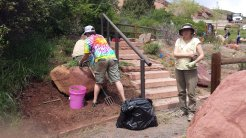 Chris, Jack, and Joan working on the weeds, making room for new plants. May 16, 2015.