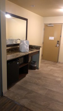 Room 4106: Spacious entry area with hard floors