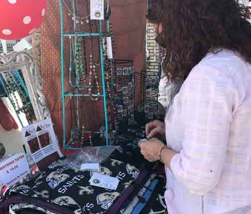 Indie Market Woman Purchasing Crafts