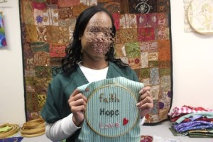 Woman Posing with Faith, Hope, Love Embroidery
