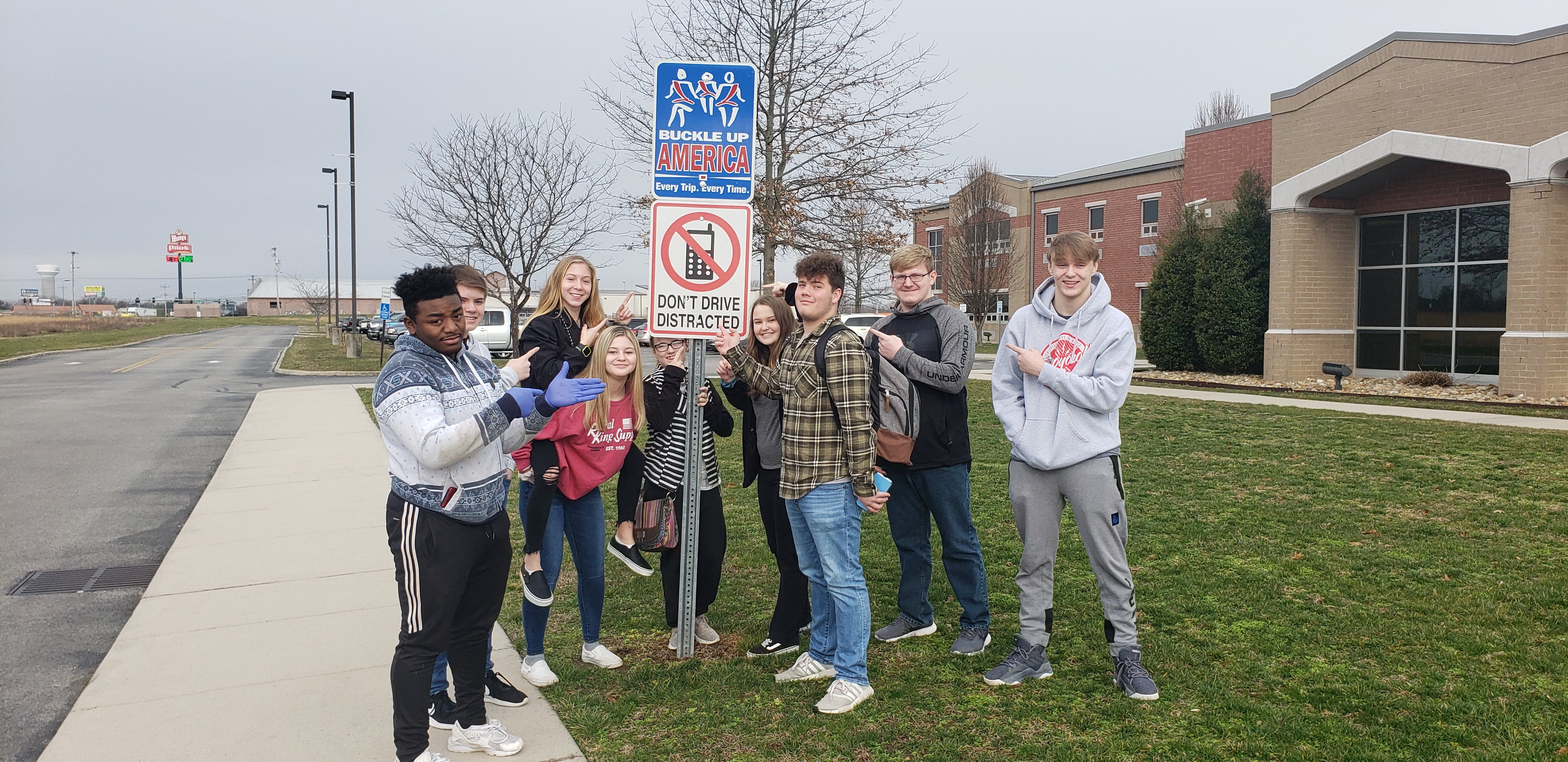 Criminal Justice Class Putting Out Metal Signs