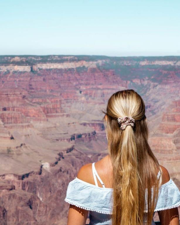 Jo standing in front of the Grand Canyon in Arizona.
