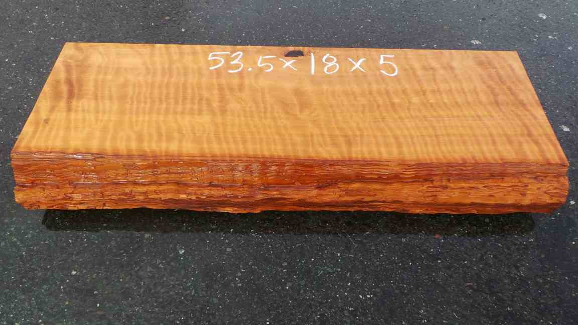 Wood fireplace mantel - curly grain redwood