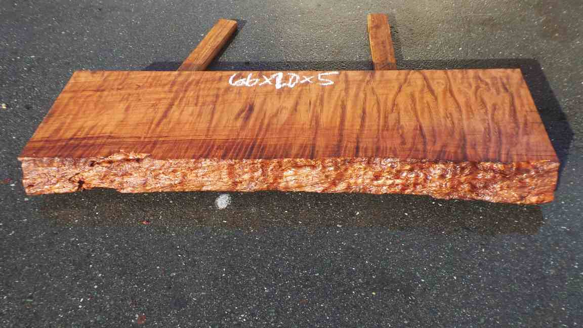 Rustic redwood fireplace mantel - consistently curly grain