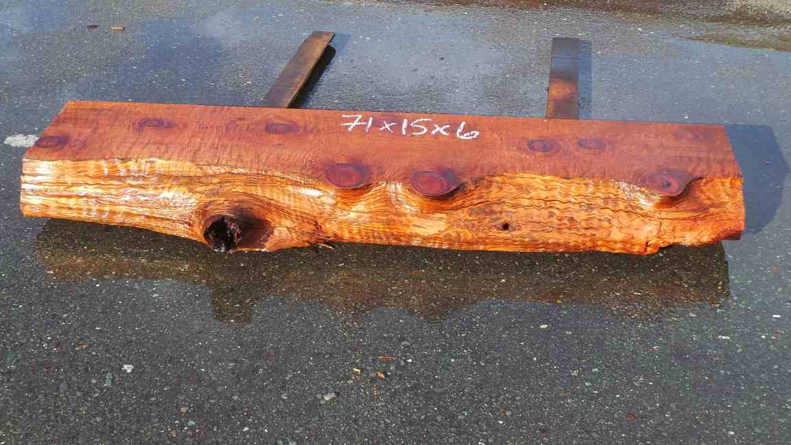Rustic fireplace mantel with live edge and knots