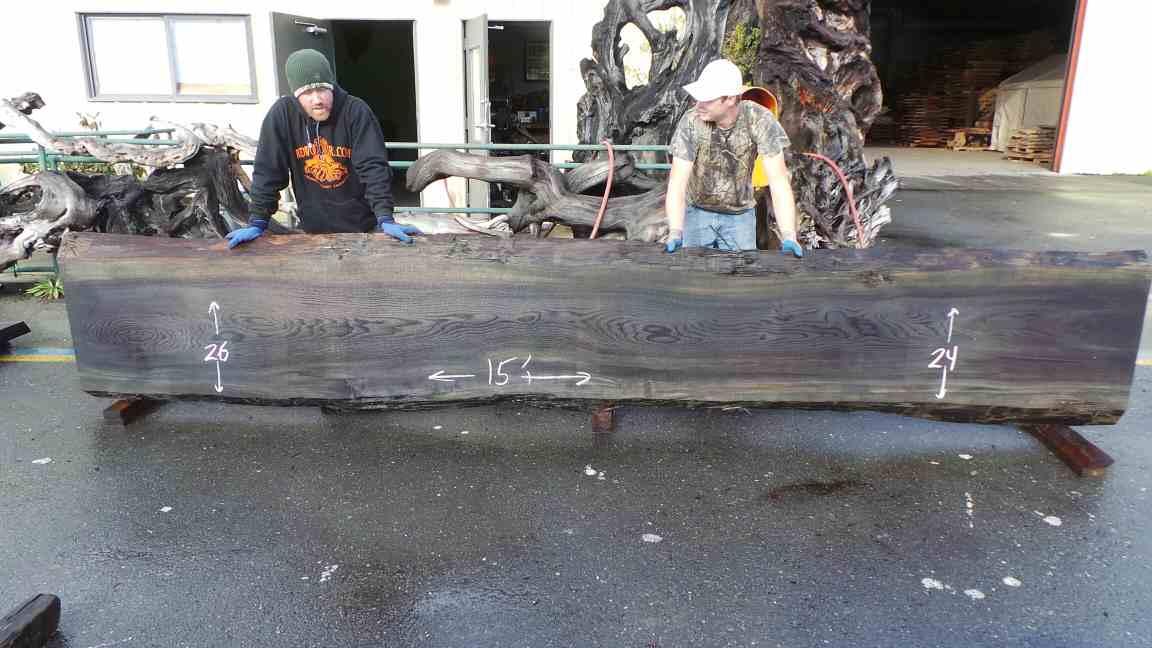 Live edge redwood slab - dark mineral stained wood