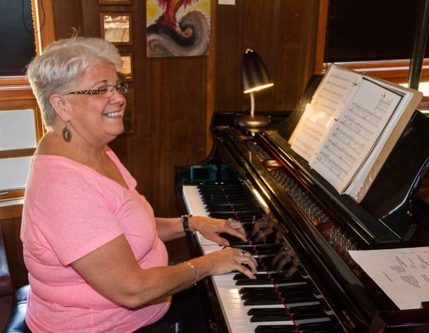 Kathleen Scott plays piano