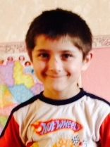 PD: Forest has brown hair & eyes, & is smiling at the camera wearing a Hot Wheels t-shirt.