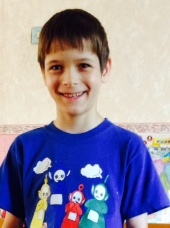 PD: Hunter has dark hair & eyes & is smiling at the camera, wearing a blue shirt.