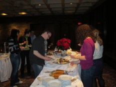 Guests gather around the appetizer table