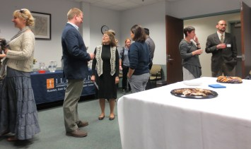 Students and faculty conversing