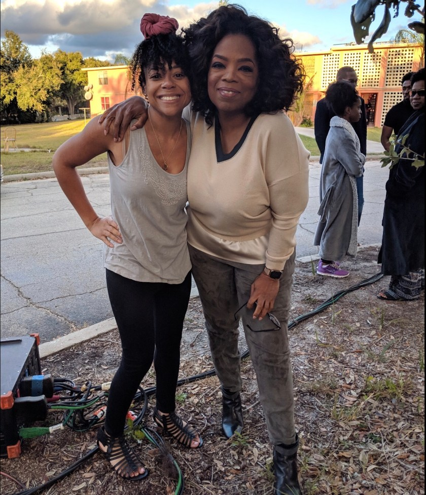 Photo of Tamara Austin with Oprah Winfrey behind the scenes of David Makes Man