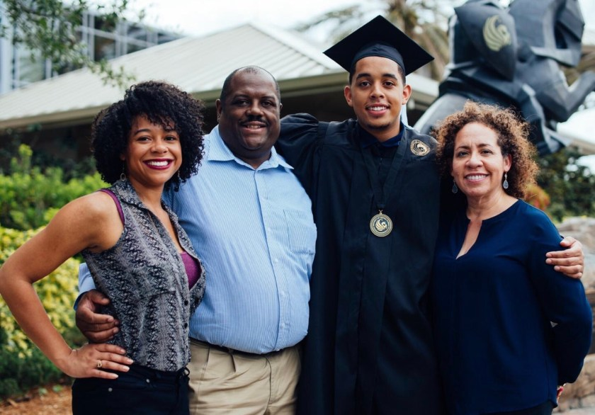 Photo of Tamara Austin and her parents at her brother's graduation