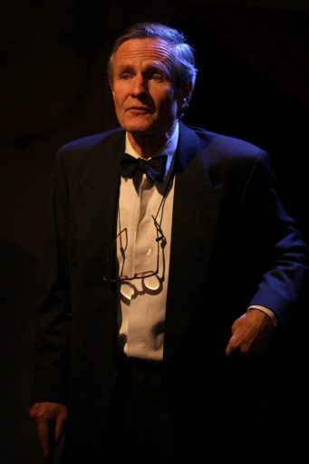 Image shows Alistair Findlay on stage in a role.