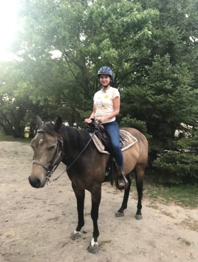 Image shows Sera-Lys McArthur horse riding in Manitoba