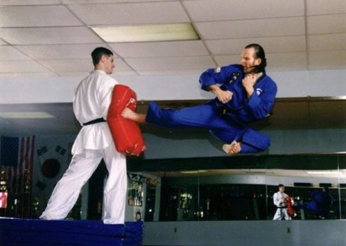 Photo shows Alex Ziwak (right) demonstrating a Tae Kwon Do kick