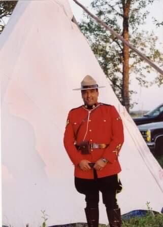 Dan Bradford outside a teepee wearing a full RMCP dress uniform