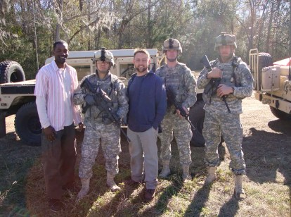 Derek Roberts far left with Garret Kruithof centre and 3 other cast members on the set of Army Wivesm