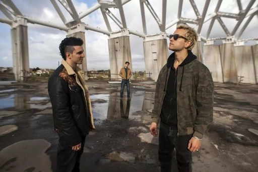 Scene from Suburra: Blood on Rome at the top of the derelict building with Aureliano (right) Spadino (left) and Lele (centre)