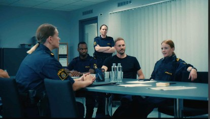 Scene from Mountain Reacue in the Police Station. Cast includes Andréas Utterhall as Johan and Karin Bengtsson as Åsa