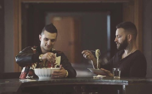 Spadino (left) and Aureliano (right) eating spaghetti in a scene from Suburra: Blood on Rome
