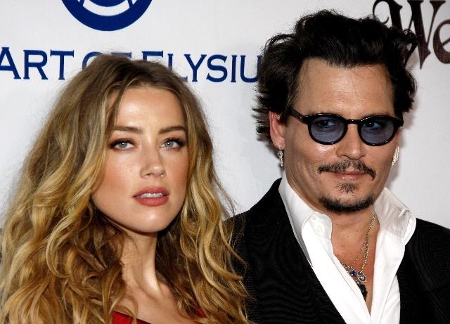 Amber Heard left 'naked, bleeding' while Depp peed
