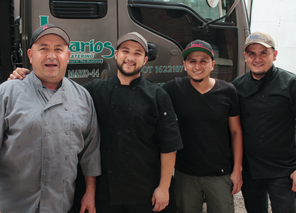 Mario Aguirre (left) and the catering crew