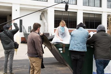 Staley on location acting in a dumpster