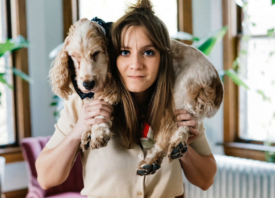 """Amanda Speva poses with her """"handsome, very patient dog,"""" Ralley"""