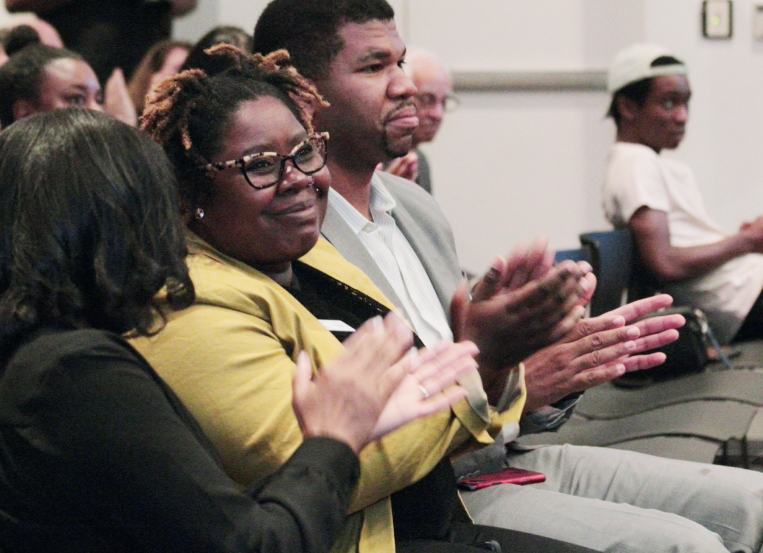 Attendees applaud the panel discussion at Free Spirit's Building Bridges' event